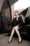 Businesswoman sitting in car on the phone Stock Image