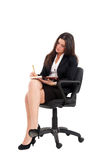 Businesswoman sitting on a chair Royalty Free Stock Photos