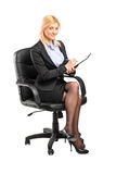 Businesswoman sitting on a chair Stock Photography