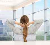 Businesswoman sitting on chair from back Royalty Free Stock Image