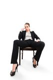 Businesswoman sitting on a chair isolated on white Stock Photos