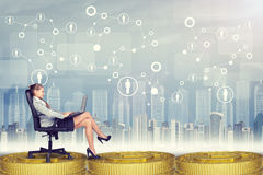 Businesswoman sitting in chair with laptop Stock Photo