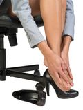 Businesswoman sitting on chair and massaging her Stock Photography