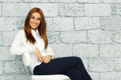 Businesswoman sitting on the chair at office Royalty Free Stock Image