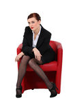 Businesswoman sitting in a chair Stock Photos
