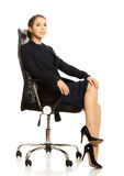 Businesswoman sitting on chair Royalty Free Stock Photography