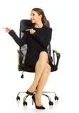 Businesswoman sitting on chair Stock Photos