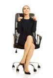 Businesswoman sitting on chair Stock Photo