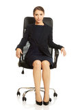 Businesswoman sitting on chair Stock Image