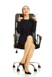 Businesswoman sitting on chair Stock Photography