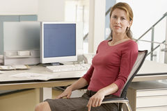 Businesswoman Sitting At Computer Desk Stock Images