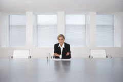 Businesswoman Sitting At Conference Table Stock Photography