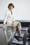 Businesswoman Sitting On Conference Table Royalty Free Stock Photos