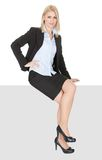 Businesswoman sitting on copyspace Stock Images