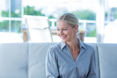 Businesswoman sitting on couch Stock Photography