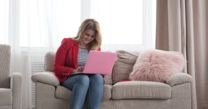 Woman working on laptop at home stock footage