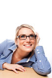 Businesswoman sitting daydreaming in the office Royalty Free Stock Photo