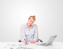 Businesswoman sitting at desc Stock Images