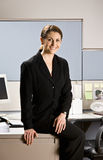 Businesswoman sitting on desk Royalty Free Stock Photography