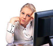 Businesswoman sitting at desk Stock Photos
