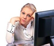 Businesswoman sitting at desk Stock Photos