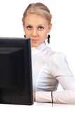 Businesswoman sitting at desk Royalty Free Stock Photo