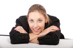 Businesswoman sitting at desk Royalty Free Stock Photography