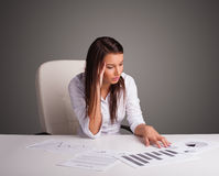 Businesswoman sitting at desk and doing paperwork Stock Photo