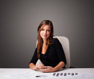 Businesswoman sitting at desk and doing paperwork Royalty Free Stock Photos