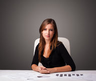 Businesswoman sitting at desk and doing paperwork Stock Photography