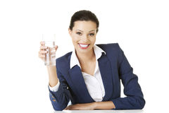 Businesswoman sitting at the desk with mineral water Royalty Free Stock Images