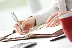 Businesswoman sitting at desk in office. Royalty Free Stock Images