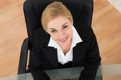 Businesswoman Sitting At Desk Stock Images