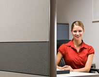 Businesswoman sitting at desk smiling Stock Photography