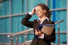 Businesswoman sitting with documents and laptop Stock Image