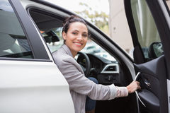 Businesswoman sitting in drivers seat. In her car royalty free stock photos