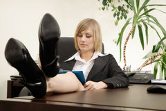 Businesswoman sitting with feet up on desk Royalty Free Stock Image