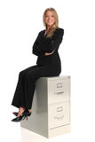 Businesswoman Sitting on File Cabinet Stock Images