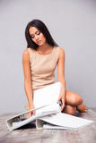 Businesswoman sitting on the floor with folders Stock Image