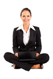Businesswoman sitting on floor with laptop Royalty Free Stock Images