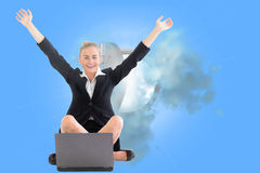 Businesswoman sitting in front of laptop with arms up Royalty Free Stock Photo