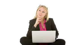 Businesswoman Sitting In Front Of Laptop Thinking Stock Image