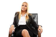 Businesswoman sitting in her chair Stock Photos