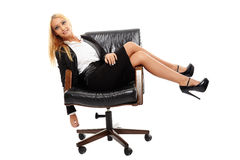Businesswoman sitting in her chair Stock Photography