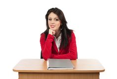 Businesswoman sitting at her desk Royalty Free Stock Photos