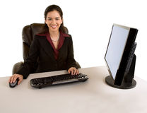 Businesswoman Sitting at her Desk Royalty Free Stock Photography