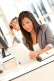 Businesswoman sitting at her desk Stock Photography