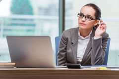 The businesswoman sitting at her desk in business concept Royalty Free Stock Photos
