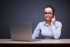 The businesswoman sitting at her desk in business concept Stock Photo