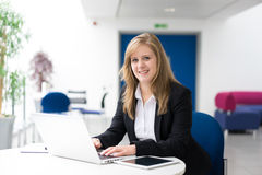 Businesswoman sitting at her desk in an office Stock Image